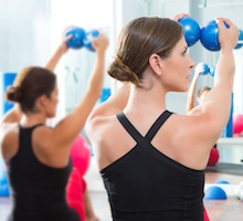 Pilates toning ball in women fitness class, yoga and fitness