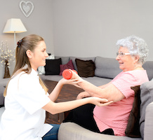 Elderly women having physical rehabilitation at home