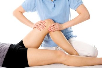 Physiotherapy leg injury being examined